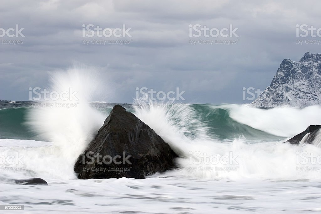 waves crashing on rocky beach royalty-free stock photo