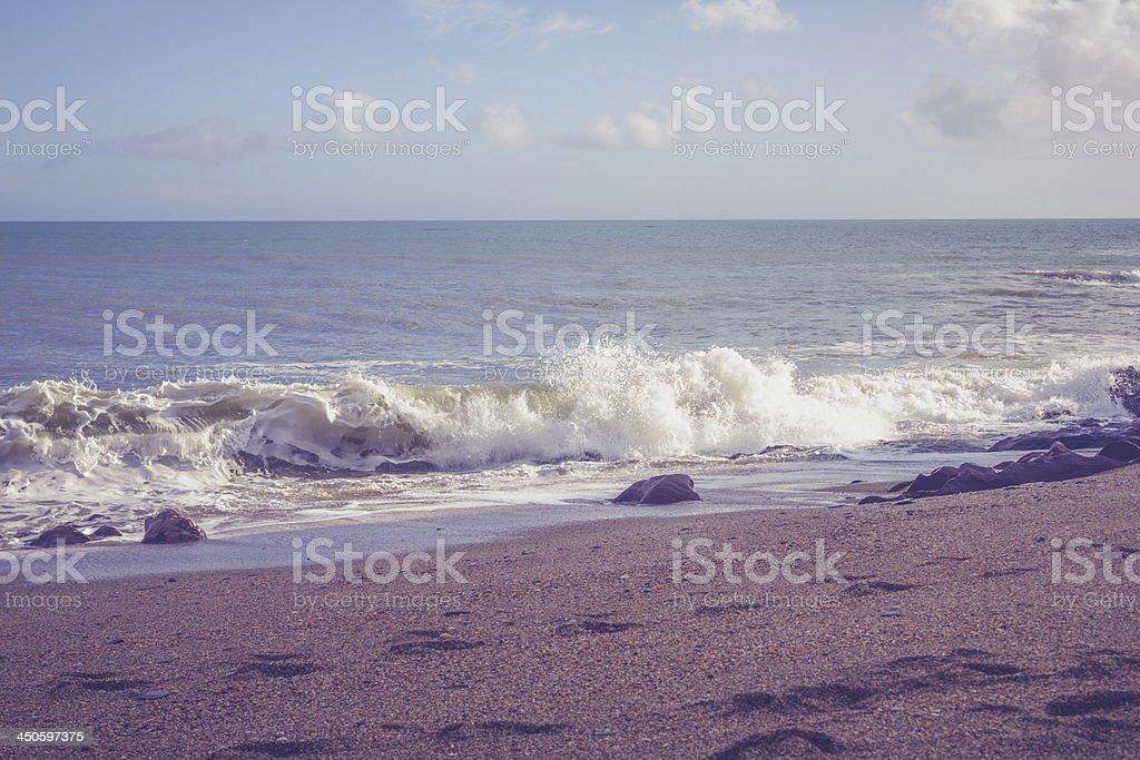 Waves crashing on shingle beach royalty-free stock photo