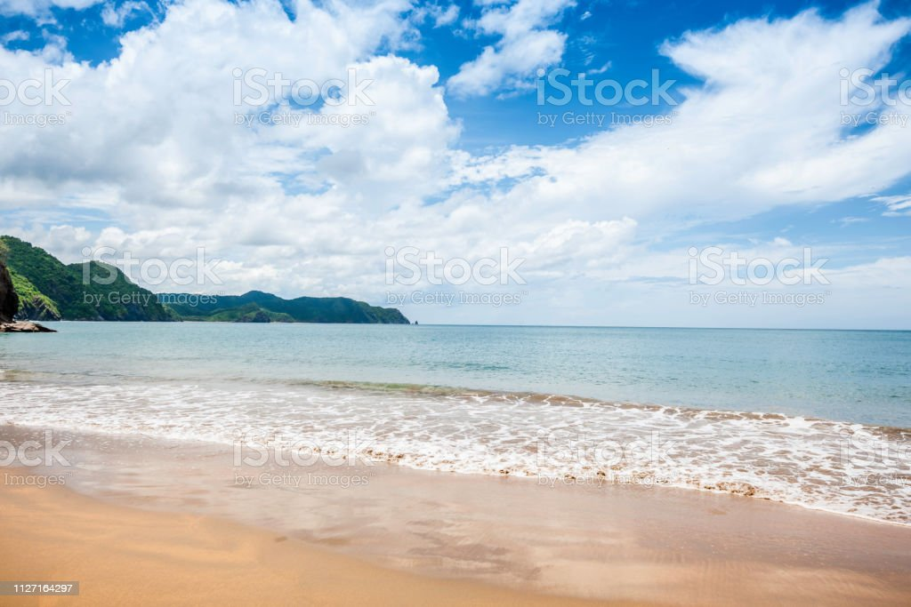 Waves Crashing On Shore On A Tropical Beach Stock Photo - Download