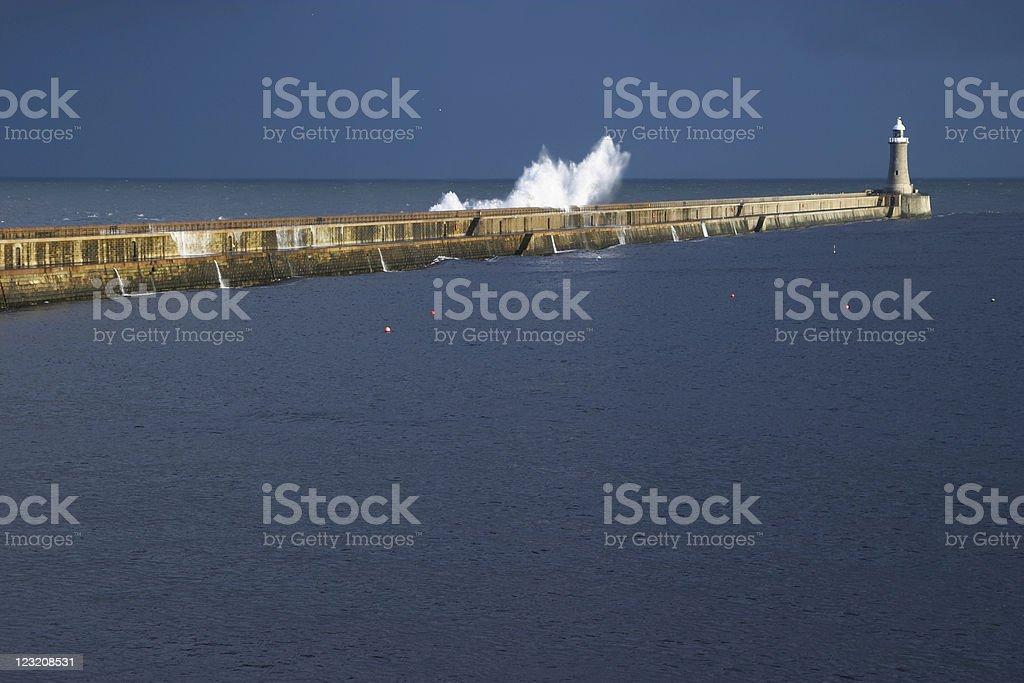 Waves crashing over pier  Breaking Stock Photo