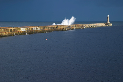 Waves Crashing Over Pier Stock Photo - Download Image Now