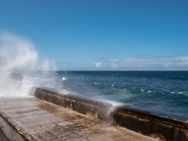 Waves crashing over the Malecon sea wall in Havana stock photo