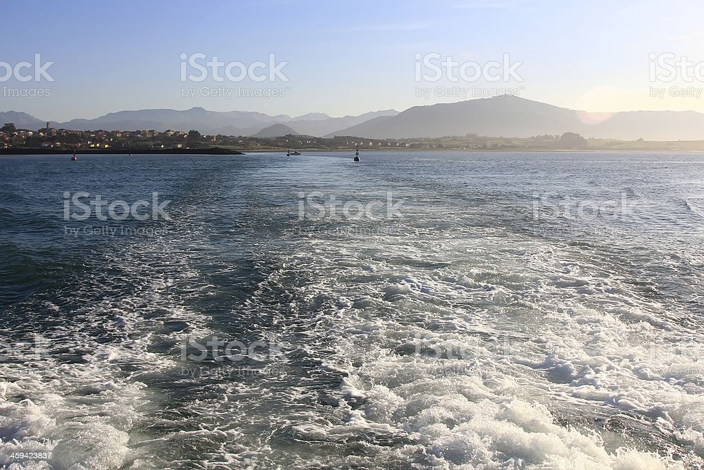 waves formed by the engine of a ship at sea royalty-free stock photo