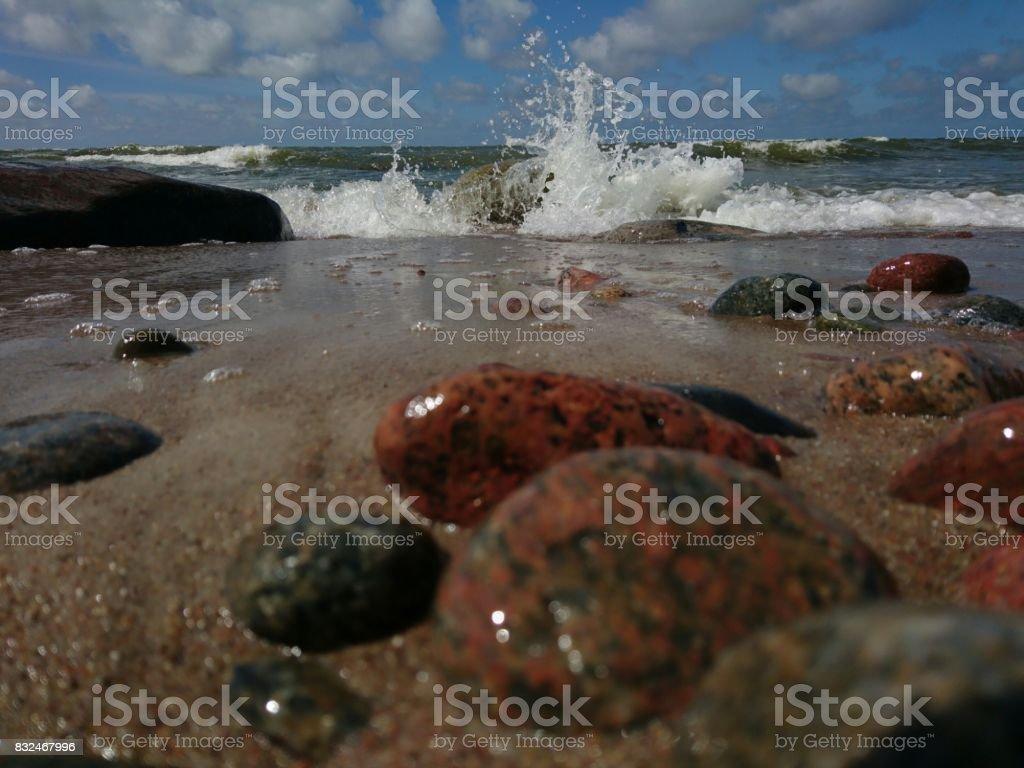 Waves hit to stones stock photo