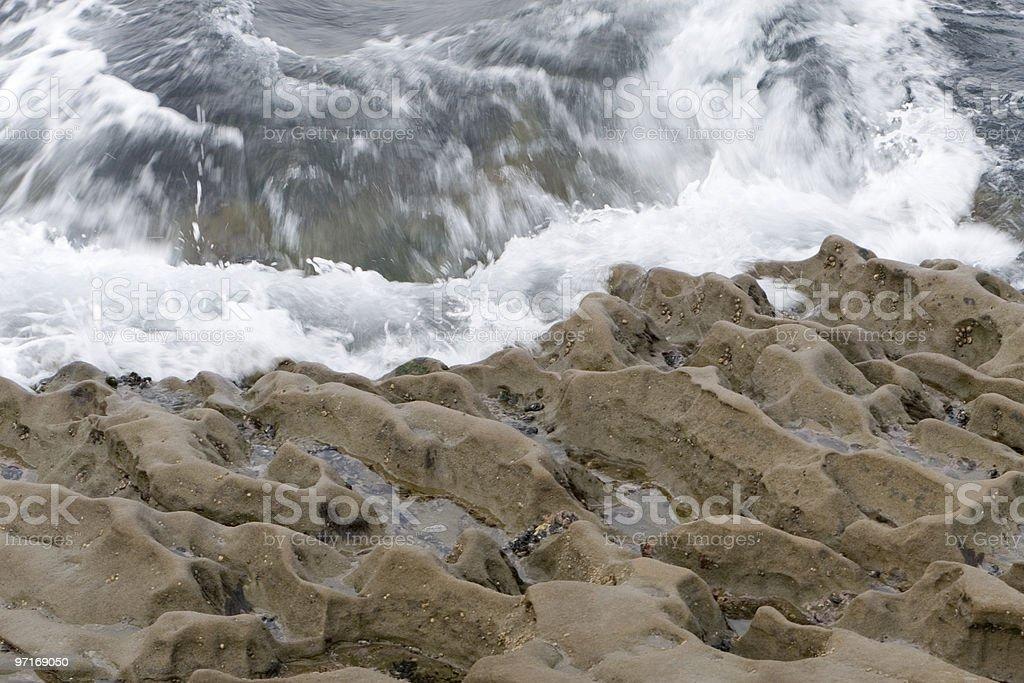 Waves hitting rocks royalty-free stock photo