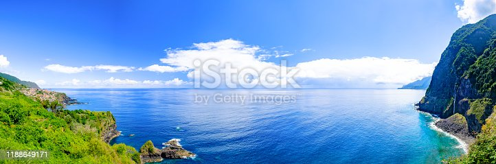 Waves hitting the coast of Madeira island at the North coast near São Vicente during a beautiful summer day.
