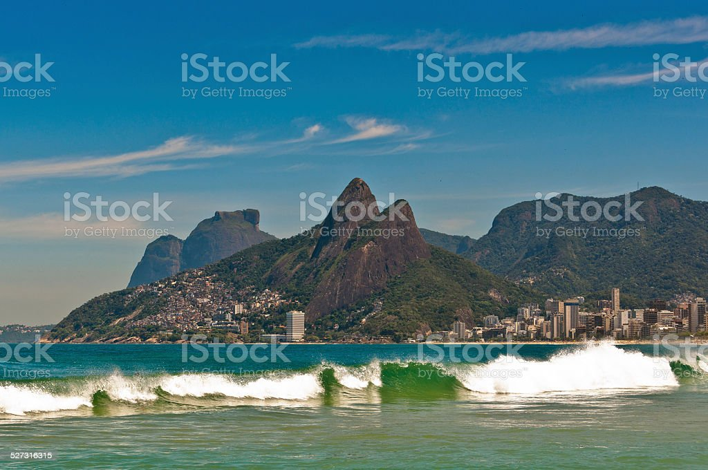 Waves in Ocean at Ipanema Beach with Mountain Landscape stock photo