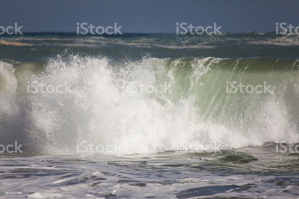 Waves in the beach of La Arnia, Liencres, Cantabria royalty-free stock photo