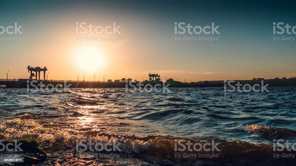 Waves in water reservoir at sunset time in evening, beautiful summer landscape - Royalty-free Accidents and Disasters Stock Photo