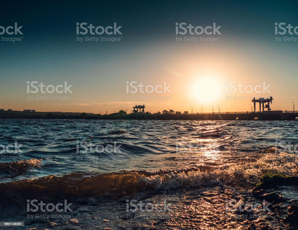 Waves in water reservoir at sunset time in evening, beautiful summer landscape zbiór zdjęć royalty-free