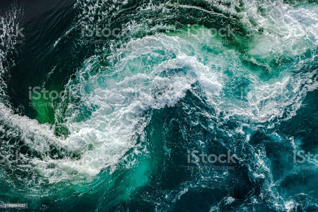 Waves of water of the river and the sea meet each other during high tide and low tide. - Royalty-free Abstract Stock Photo