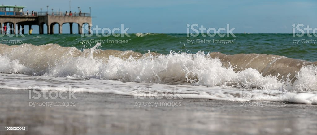 Waves on a sandy beach in Bournemouth stock photo
