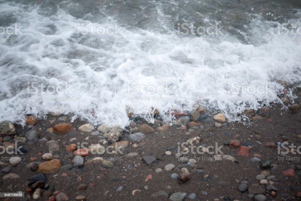 Waves on Pebble Beach stock photo