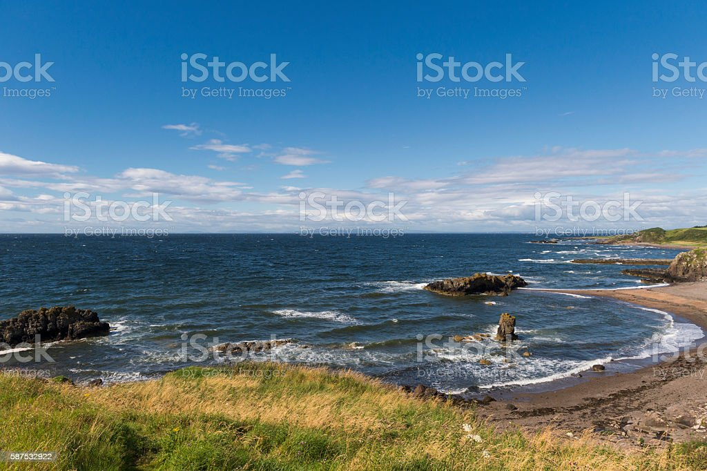 Waves on the Ayrshire coastline in Scotland during summer stock photo