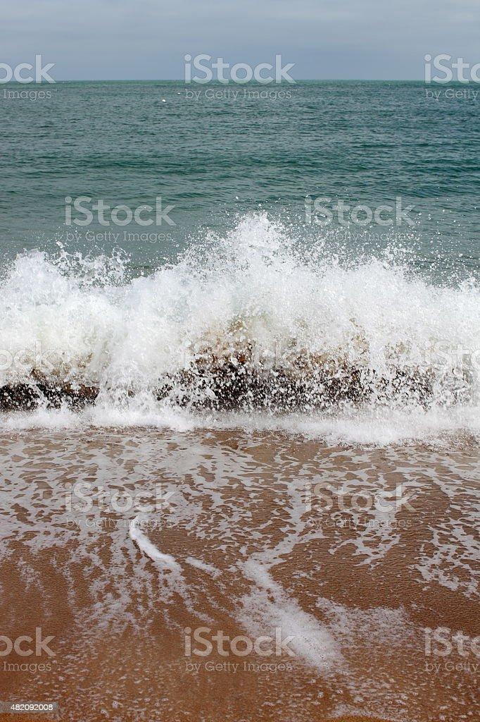 Waves on the beach stock photo