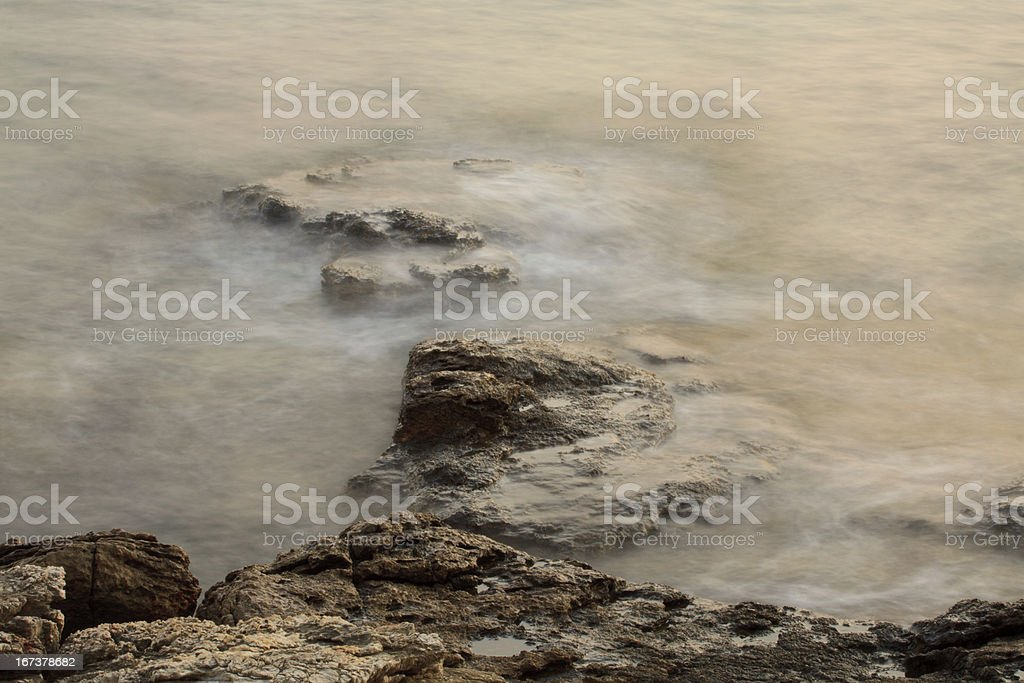 waves on the rocks royalty-free stock photo