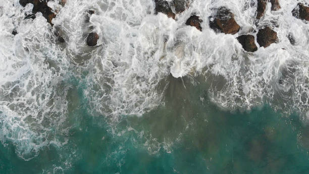 Waves Over Rocky Sea stock photo