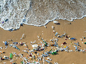 istock Waves pushing plastic waste to the beach 1208182476