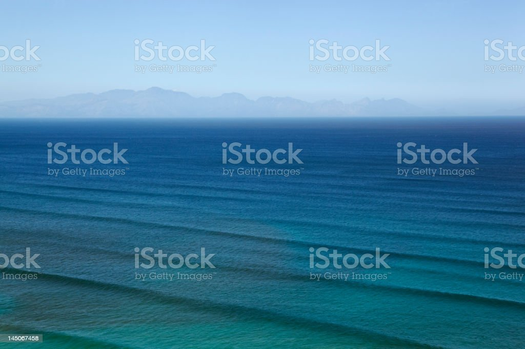 Waves rippling on calm ocean waters stock photo