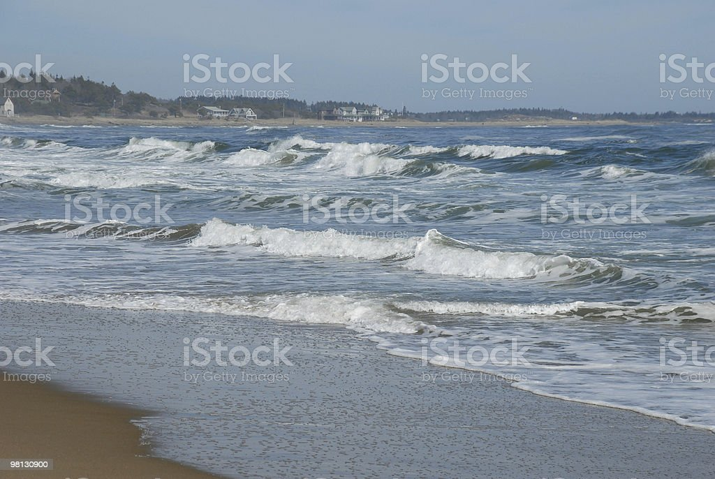 Waves roll ashore at Popham Beach in Maine royalty-free stock photo