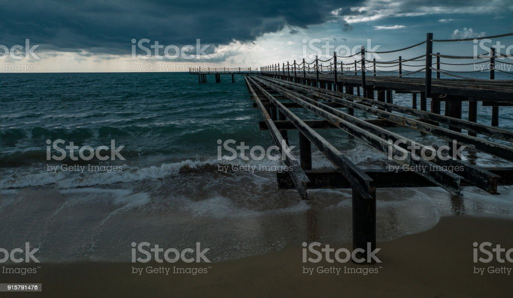 Waves roll over pebbles in sea stock photo