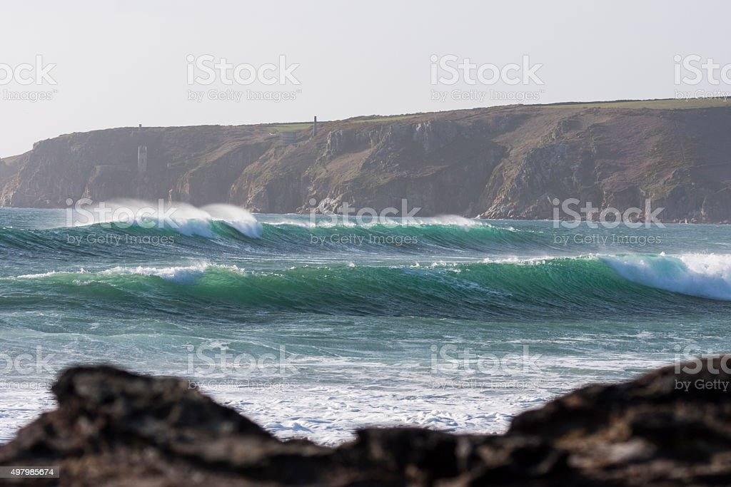Waves rolling in at Porthleven on the coast of Cornwall stock photo