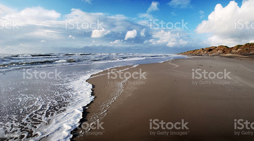 Waves rolling up a stormy beach at Løkken, Denmark(XL) royalty-free stock photo