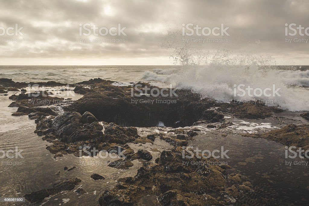 Waves splashing at Thor's Well stock photo