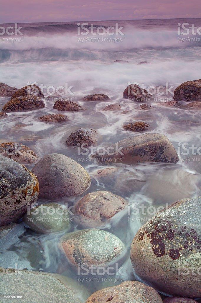 Waves splashing at Valugan Boulder Beach in Batanes, Philippines stock photo