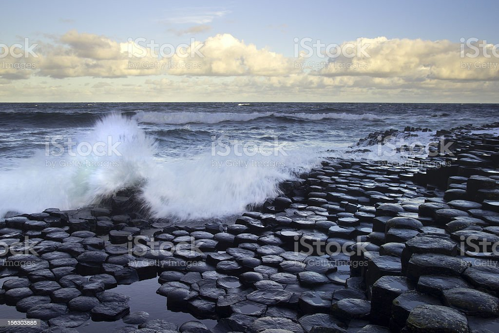 Waves splashing on stones from the Giant's Causeway stock photo