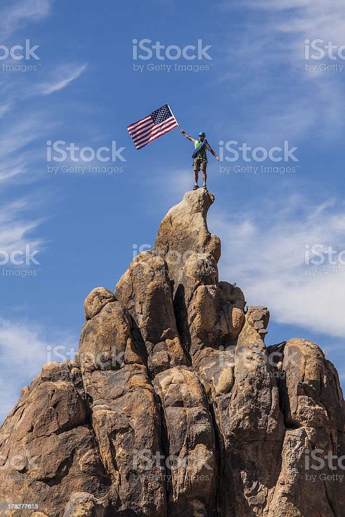 Waving a flag on the summit. stock photo