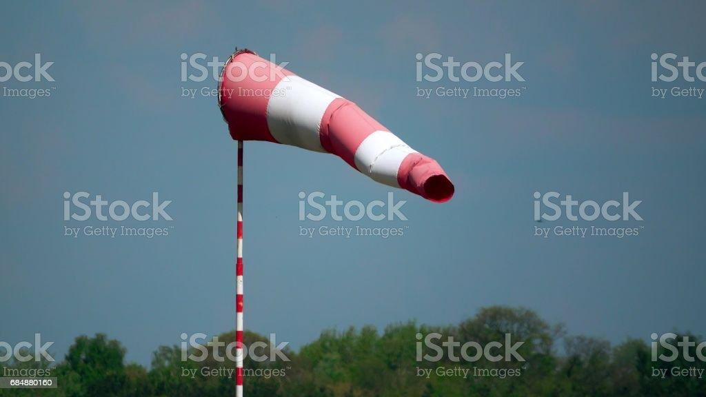 Waving airport weather vane or striped wind flag telephoto lens shot Lizenzfreies stock-foto