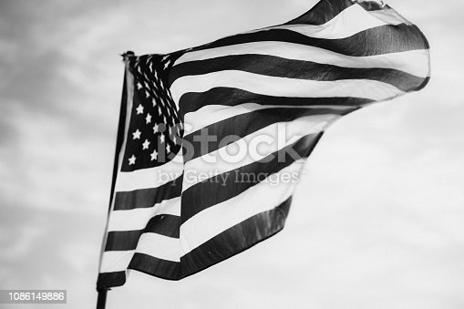 947881968istockphoto Waving American Flag in Black and White 1086149886