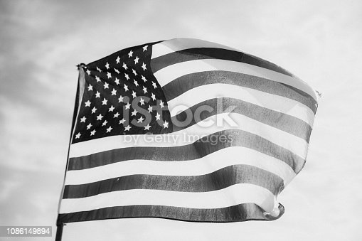 947881968istockphoto Waving American Flag in Black and White 1086149894