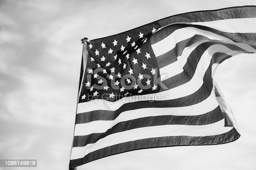 947881968istockphoto Waving American Flag in Black and White 1086149918