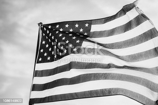 947881968istockphoto Waving American Flag in Black and White 1086149922