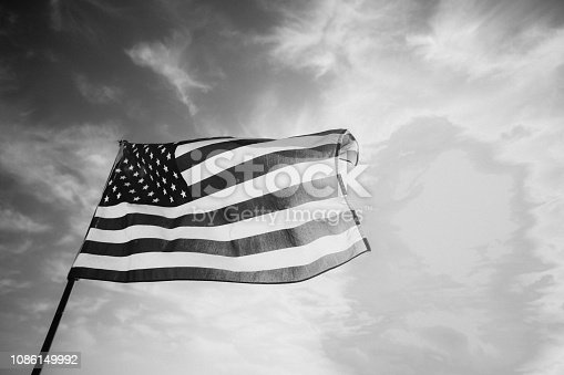 istock Waving American Flag in Black and White 1086149992