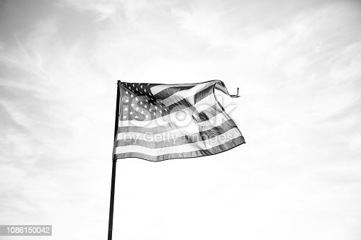 istock Waving American Flag in Black and White 1086150042