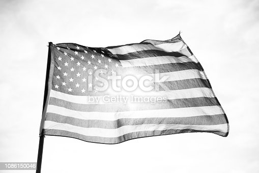 947881968istockphoto Waving American Flag in Black and White 1086150046