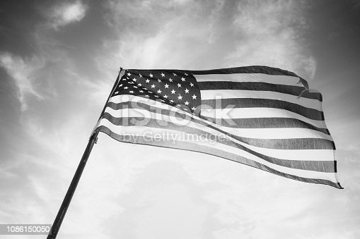 947881968istockphoto Waving American Flag in Black and White 1086150050