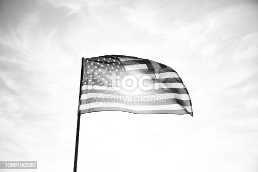 947881968istockphoto Waving American Flag in Black and White 1086150080