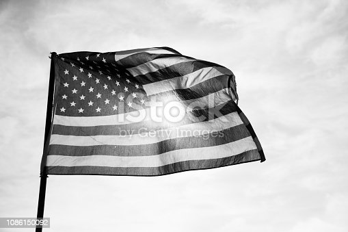 947881968istockphoto Waving American Flag in Black and White 1086150092