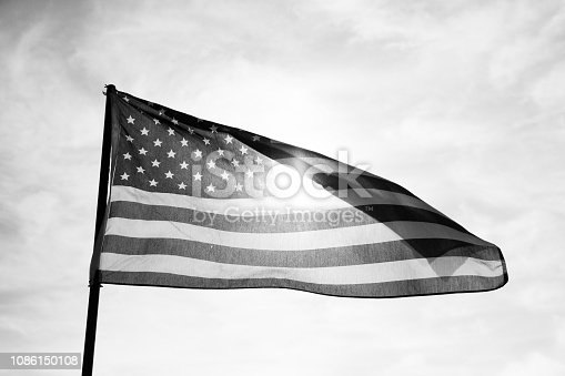 947881968istockphoto Waving American Flag in Black and White 1086150108