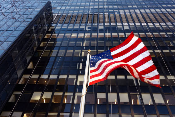 Waving American flag on the background of skyscraper in New York, usa. stock photo