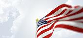 Waving American flag horizontal on sky background