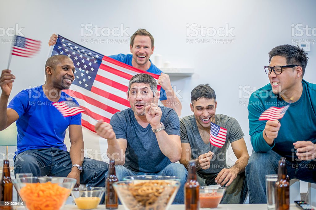 Waving American Flags While Watching the Super Bowl stock photo