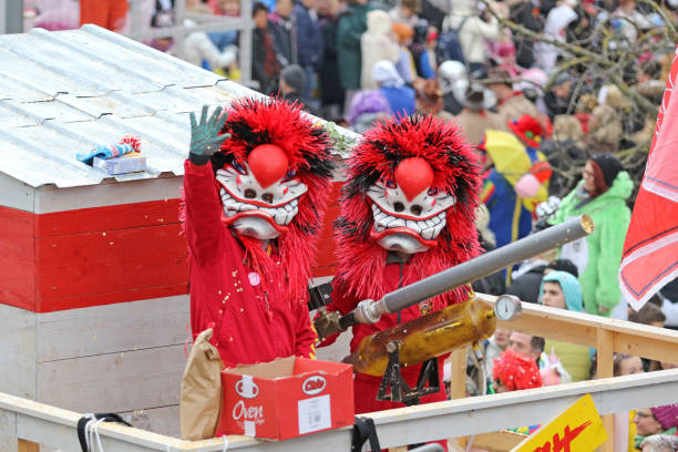 waving at the fasnacht - welcome march stock photos and pictures