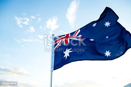 Waving Australia flag in the air.
