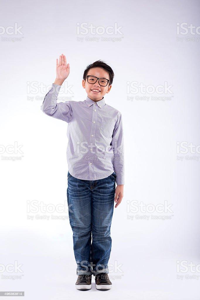 Waving boy stock photo