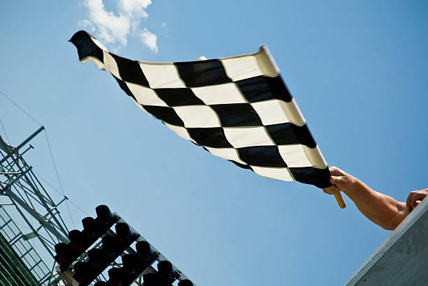 Waving check flag - motion blur stock photo